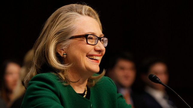 Secretary of State Hillary Clinton laughs at a comment before testifying before the Senate Foreign Relations Committee hearing on the terrorist attacks on the U.S. Embassy in Benghazi, in Washington, DC on January 23, 2013. UPI/Molly Riley