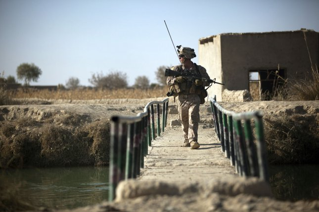 U.S. Marine Lance Cpl. Joshua Prall, rifleman with 3rd Platoon, Lima Company, 3rd Battalion, 3rd Marine Regiment scans the area while crossing a bridge during a partnered security patrol with Afghan National Army soldiers in Helmand Province Afghanistan Dec. 18, 2011. UPI/U.S. Marine Corps/Cpl. Reece Lodder