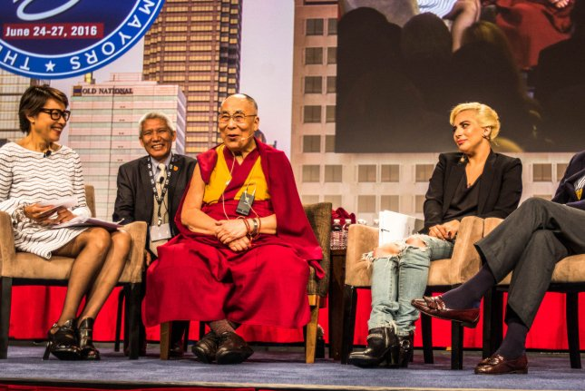Ann Curry (L) moderates a question and answer session with the Dalai Lama, Lady Gaga, and Philanthropist Philip Anschutz during the U.S. Conference of Mayors on Sunday in Indianapolis, Indiana.Photo by Edwin Locke/UPI
