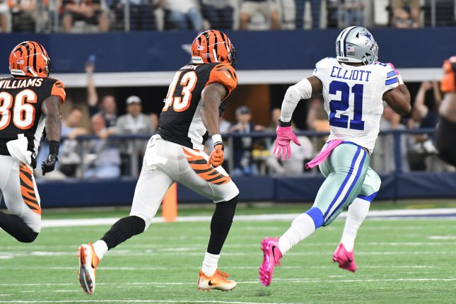Dallas Cowboys running back Ezekiel Elliott gets free for a 60-yard touchdown run against the Cincinnati Bengals during the first half at AT&T Stadium in Arlington, Texas on October 9, 2016. Ian Halperin/UPI