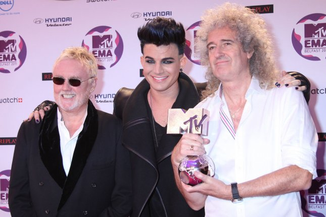 Roger Taylor (L) and Brian May (R) of Queen arrive on the red carpet with Adam Lambert after receiving the Global Icon Award at the MTV Europe Music Awards on November 6, 2011. The pairing have announced a new summer tour that starts in June. File Photo by David Silpa/UPI