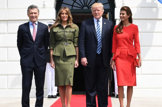 U.S. President Donald Trump and first lady Melania Trump greet Argentine President Mauricio Macri (L) and his wife Juliana Awada (R) upon arrival at the White House on Thursday. Photo by Pat Benic/UPI