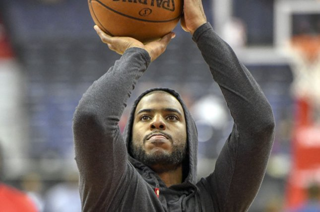 Houston Rockets guard Chris Paul (pictured) warms up on December 29, 2017 at Capital One Arena in Washington, D.C. Photo by Mark Goldman/UPI