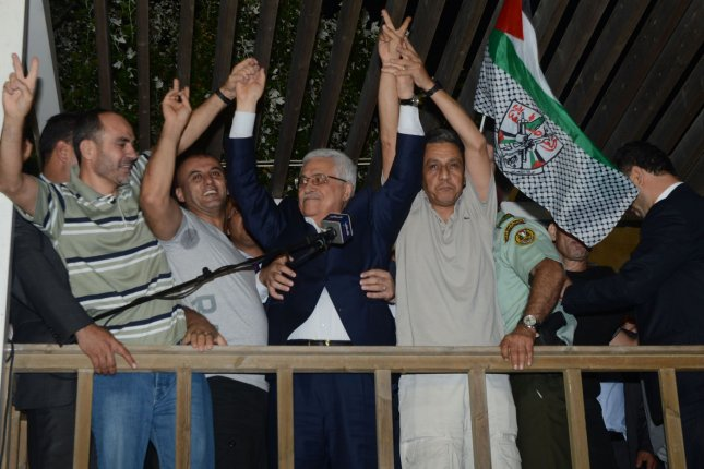 Palestinian Authority President Mahmoud Abbas welcomes prisoners released from Israeli prison in the West Bank town of Ramallah early August 14, 2013. File Photo by Thaer Ghanaim/UPI