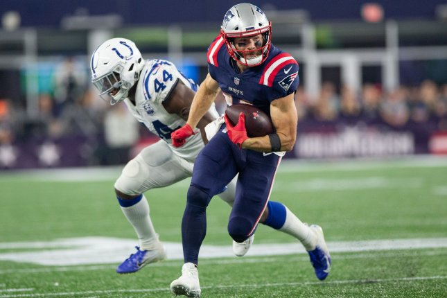 New England Patriots wide receiver Julian Edelman (11) dodges a tackle by Indianapolis Colts linebacker Zaire Franklin on a reception in the fourth quarter at Gillette Stadium in Foxborough, Massachusetts on October 4, 2018. The Patriots defeated the Colts 38-24. Photo by Matthew Healey/UPI