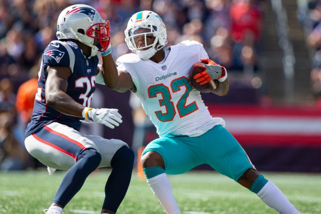 Miami Dolphins running back Kenyan Drake (32) provided the play of the game against the New England Patriots on Sunday in Miami. Photo by Matthew Healey/UPI