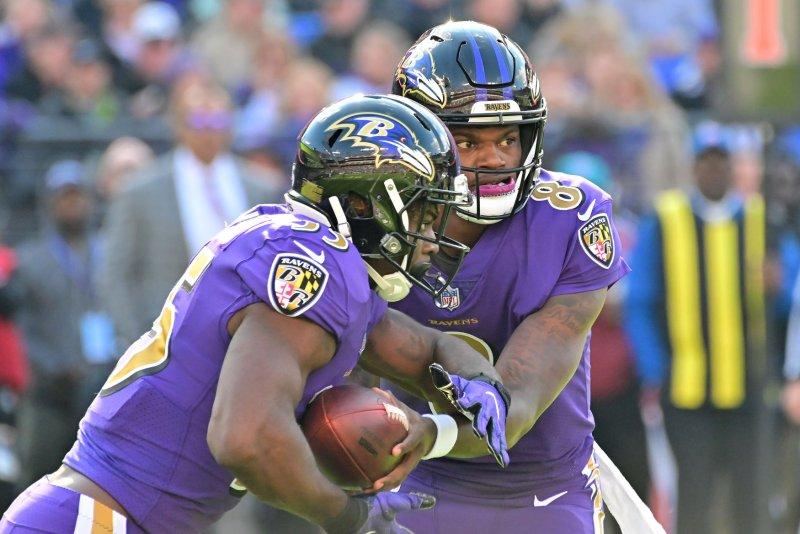 Baltimore Ravens quarterback Lamar Jackson (8) hands off to Baltimore Ravens running back Gus Edwards (35) during the first half of an NFL game at M&T Bank Stadium in Baltimore, Maryland, November 25, 2018. Photo by David Tulis/UPI