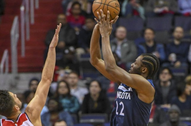 Minnesota Timberwolves forward Andrew Wiggins shoots over Washington Wizards guard Tomas Satoransky at Capital One Arena in Washington, D.C. on March 13, 2018. Photo by Mark Goldman/UPI