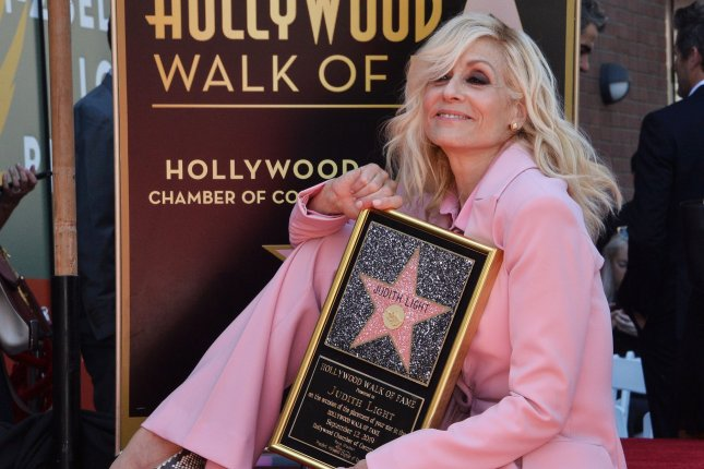 Judith Light holds a replica plaque during an unveiling ceremony honoring her with the 2,673rd star on the Hollywood Walk of Fame on Thursday. Photo by Jim Ruymen/UPI