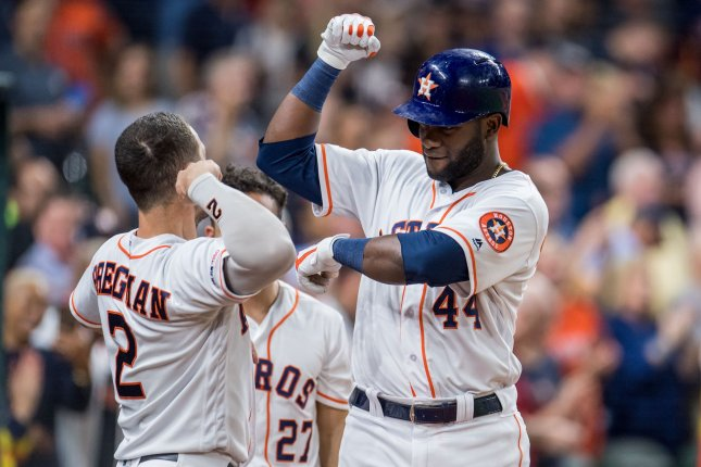 Houston Astros teammates Yordan Alvarez (R) and Alex Bregman (L) both homered in the sixth inning of a win against the Texans Rangers Tuesday in Houston. Photo by Trask Smith/UPI