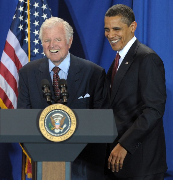 U.S. President Barack Obama shares a laugh with Sen. Edward Kennedy, D-MA, before signing the Edward M. Kennedy Serve America Act at the SEED Public Charter School on April 21, 2009. Obama called on Americans to serve their communities and work together to tackle tough challenges. (UPI Photo/Roger L. Wollenberg)