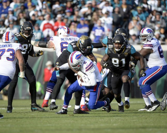 Buffalo Bills quarterback Tyrod Taylor is sacked by the Jacksonville Jaguars defense during an NFL Wild Card game at EverBank Field on January 7. Photo by Joe Marino/Bill Cantrell