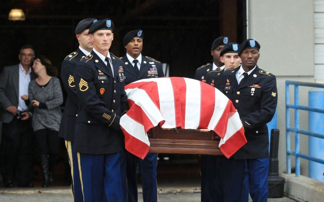 U.S. servicemen carry the casket containing the remains of U.S. Army Corporal Donald Matney whose remains were recently identified after he died during the Korean War. Secretary of State Mike Pompeo said Sunday the U.S. and North Korea agreed to resume a search for the remains of an estimated 5,300 U.S. soldiers who never returned from the Korean War. Photo by Bill Greenblatt/UPI