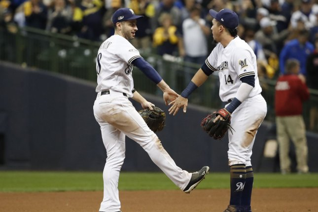 Milwaukee Brewers outfielder Ryan Braun (L) and Hernan Perez slap hands while celebrating a win over the Los Angeles Dodgers in National League Championship Series game six on Friday at Miller Park. Photo by Kamil Krzaczynski/UPI