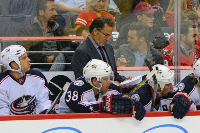 Columbus Blue Jackets assistant Brad Larsen will replace former head coach John Tortorella (C), who was not under contract for the 2021-22 season. File Photo by Mark Goldman/UPI