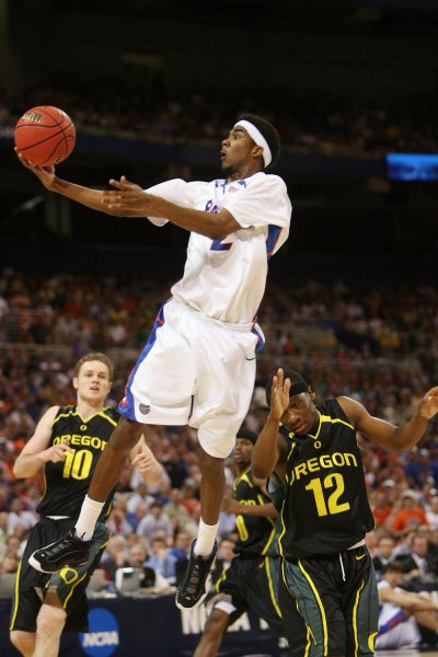 Florida Gators Corey Brewer flies past the Oregon Ducks defense for a basket in the first half of the NCAA Midwest Regional at the Edward Jones Dome in St. Louis on March 25, 2007. Florida won the game 85-77. (UPI Photo/Bill Greenblatt)