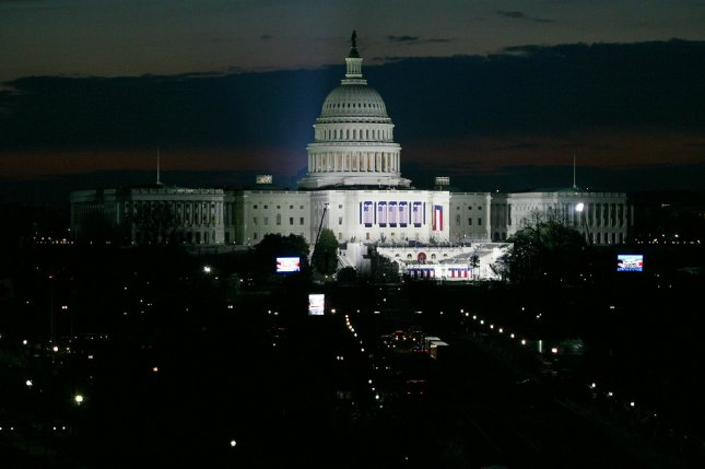 The Capitol dome is illuminated at night. Some 200 Democratic lawmakers had their personal information hacked and posted online, including personal cellphone numbers, by suspected Russian spies. File photo by Arianne Teeple/UPI