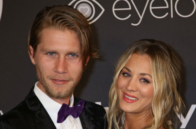 Kaley Cuoco (R), pictured with Karl Cook, visited The Happiest Place on Earth with Cook and other family and friends following her engagement to the equestrian. File Photo by David Silpa/UPI
