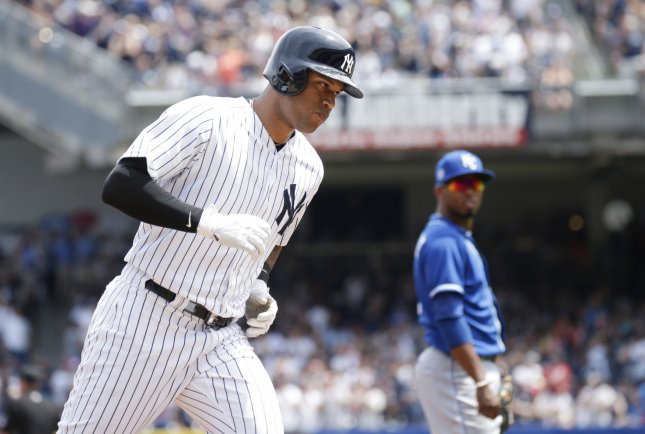 Aaron Hicks and the New York Yankees take on the Texas Rangers on Friday. Photo by John Angelillo/UPI