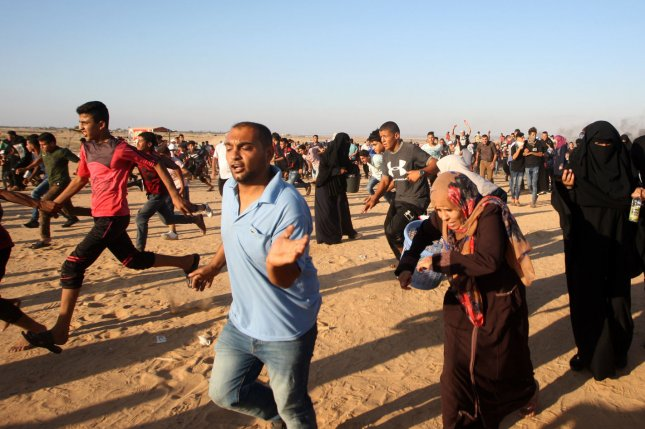 Palestinian protesters fled from the shooting during a demonstration at the Israel-Gaza border in Rafah, in the southern Gaza Strip, on Aug 10. Two Palestinians died and 270 people were injured the next Friday as the weekly Great March of Return protests continued. File Photo by Ismael Mohamad/UPI