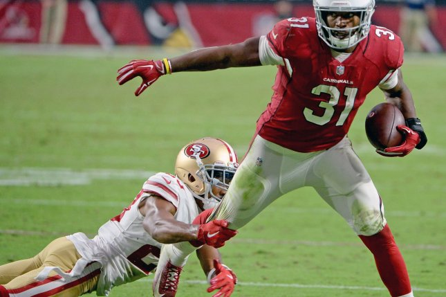 San Francisco 49ers defensive back Ahkello Witherspoon tries to tackle Arizona Cardinals running back David Johnson at State Farm Stadium in Glendale, Arizona on October 28, 2018. Photo by Art Foxall/UPI