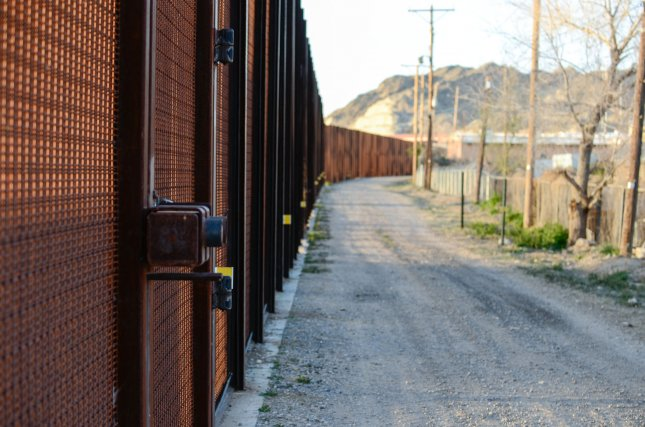The border fence runs just behind Doniphan Park in El Paso, Texas, separating the city from Juarez, Mexico. It was built a decade ago as part of the Secure Fences Act of 2006 under President George Bush. File Photo by Natalie Krebs/UPI