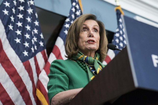 House Speaker Nancy Pelosi emerges from a closed-door Democratic caucus meeting Tuesday at the U.S. Capitol in Washington, D.C. Photo by Sarah Silbiger/UPI