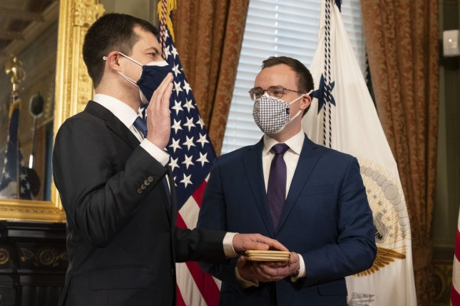 Pete Buttigieg is sworn in as transportation secretary on February 3 at the White House in Washington, D.C., as his husband Chasten Buttigieg looks on. Photo by Chris Kleponis/UPI/Pool