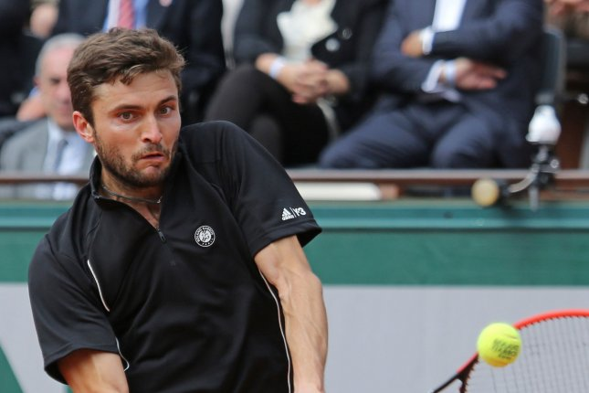 Gilles Simon of France hits a shot during his French Open men's first round match against Lucas Pouille of France at Roland Garros in Paris on May 25, 2015. Simon defeated Pouille 3-6, 6-1, 6-2, 6-4 to advance to the second round. Photo by David Silpa/UPI