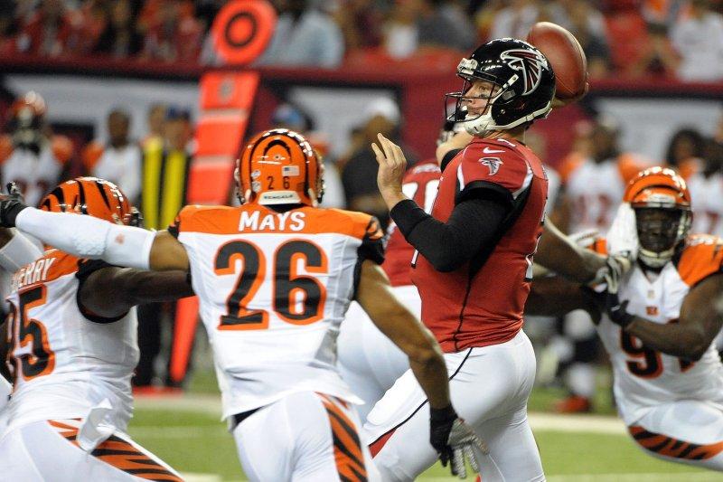 Atlanta Falcons quarterback Matt Ryan passes from the pocket under pressure from Cincinnati's Taylor Mays (26). UPI/David Tulis