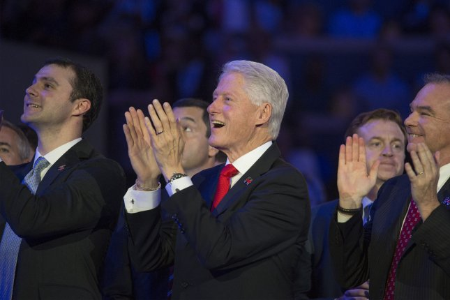Bill Clinton (C) and vice-presidential candidate Tim Kaine (R) of Virginia applaud Hillary Clinton as she delivers acceptance speech during Day four of the Democratic National Convention at Wells Fargo Center in Philadelphia, Pennsylvania on July 28, 2016. Democrat Hillary Clinton will face Republican Donald Trump in the national election. Photo by Pete Marovich/UPI