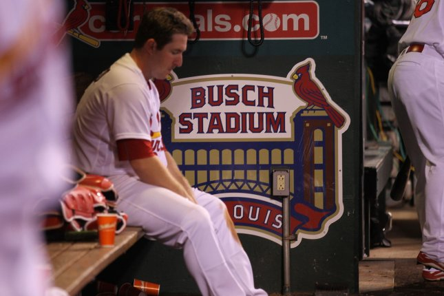 St. Louis Cardinals' Jedd Gyorko cant watch from the dugout as the Cincinnati Reds pitch to the Cardinals in the bottom of the ninth inning at Busch Stadium in St. Louis on September 26, 2016. Cincinnati defeated St. Louis 15-2. Photo by Bill Greenblatt/UPI