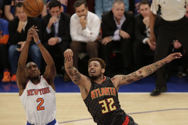 Atlanta Hawks' Mike Scott and New York Knicks Langston Galloway leap for a rebound at Madison Square Garden in New York City on October 29, 2015. Photo by John Angelillo/UPI