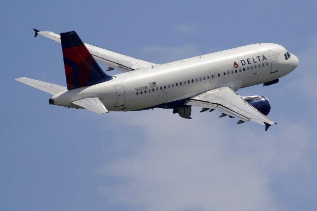 A Delta Air Lines plane takes off from LaGuardia Airport in New York City. Boeing has said it plans to begin testing pilotless aircraft next year. File Photo by John Angelillo/UPI