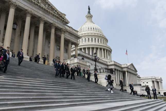 A $1.3 trillion spending bill to fund the government through September moved to the Senate Thursday, which must give unanimous consent to send it to President Donald Trump and avoid a government shutdown Friday night. Photo by Alex Edelman/UPI