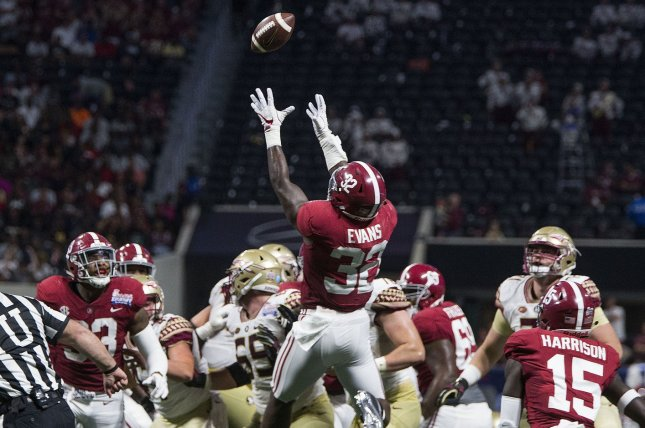 Alabama Crimson Tide linebacker Rashaan Evans (32) goes up to recover a blocked Florida State Seminoles field goal attempt to end the first half of the Chick-fil-A Kickoff game on September 2, 2017 at Mercedes-Benz Stadium in Atlanta. Photo by Mark Wallheiser/UPI