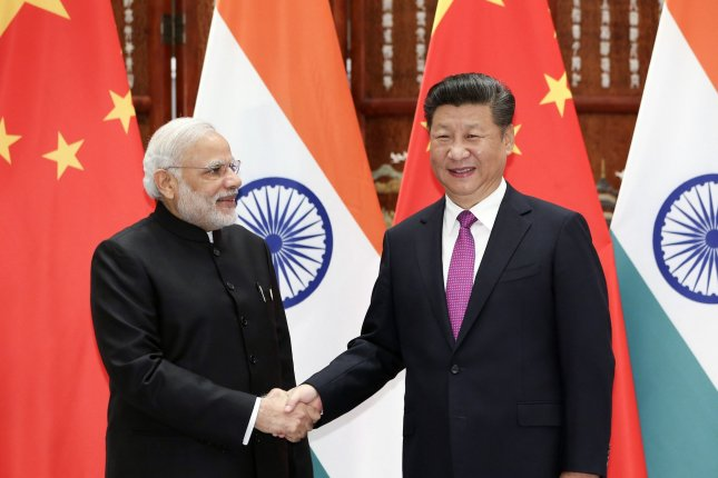 Chinese President Xi Xinping (R) and Indian Prime Minister Narendra Modi agreed to peaceful border relations on Saturday, according to a Saturday media briefing. File Photo by Ding Lin/UPI