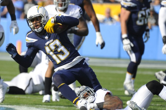 Los Angeles Chargers wide receiver Keenan Allen (13) is brought down by an Oakland Raiders defender in the first half on December 31, 2017 at StubHub Center in Carson, California. File photo by Lori Shepler/UPI