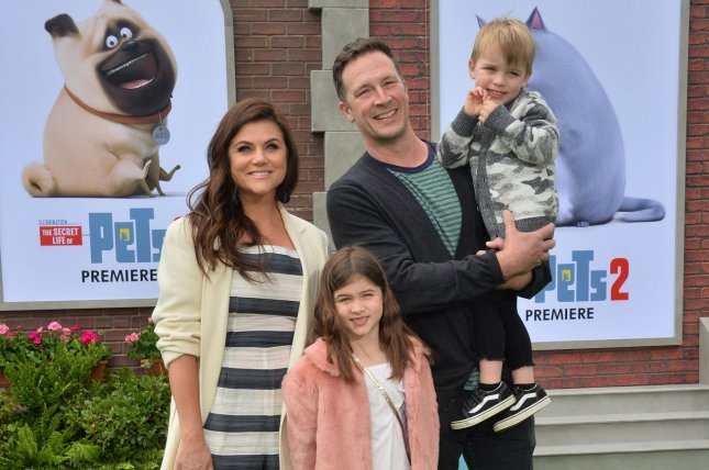 Tiffani Thiessen (L), pictured with husband Brady Smith and their children, discussed the Beverly Hills, 90210 reboot while attending the Los Angeles premiere of The Secret Life of Pets 2 on Sunday. Photo by Jim Ruymen/UPI