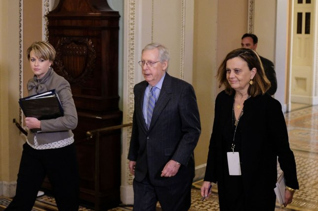 Senate Republican leader Mitch McConnell of Kentucky heads back to the Senate floor after a break during President Donald Trump's impeachment trial on Friday. Photo by Alex Wroblewski/UPI