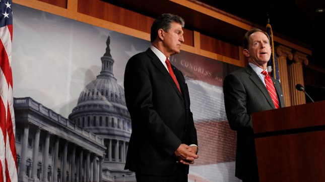 Senator Pat Toomey (R-PA), left and Senator Joe Manchin (D-WV) hold a press conference to discuss expanding background checks for firearms, in Washington DC on April 10, 2013. UPI/Molly Riley