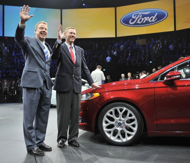 Bill Ford (L), Ford Motor Company Executive Chairman, and Alan Mulally, Ford President and CEO, pose for photos with the 2013 Fusion at the 2012 North American International Auto Show on January 9, 2012 in Detroit, Michigan. UPI/Brian Kersey