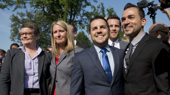 Plaintiffs, from left to right, Kris Perry, Sandy Stier, Jeff Zarrillo and Paul Katami arrive at the Supreme Court in Washington, D.C on, June 26, 2013. The Supreme Court is expected to announce its ruling on California's Proposition 8 ban on same-sex marriage and the federal Defense of Marriage Act. UPI/Kevin Dietsch