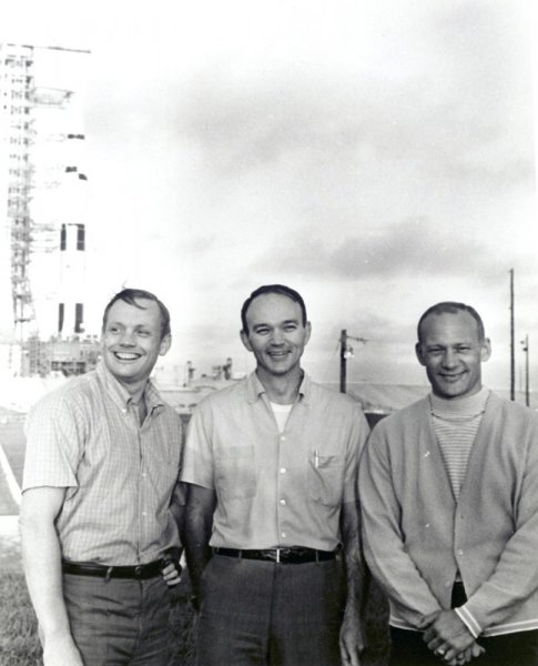 The Apollo 11 crew (L to R) Neil Armstrong, commander, Michael Collins, command module pilot, and Buzz Aldrin, lunar module pilot, stand near the Apollo/Saturn V space vehicle at Kennedy Space Center, Florida on May 20, 1969. NASA marks the 40th anniversary of the Apollo 11 mission to the Moon and the historic first moonwalk this year. During the eight-day space mission, Armstrong and Aldrin explored the Moon's surface and brought back rock samples for scientists to study. Collins piloted the command module in the lunar orbit during their 22-hour stay on the moon. (UPI Photo/NASA)