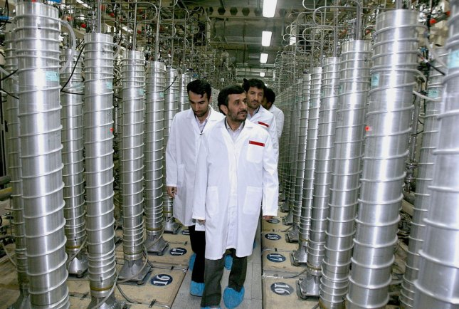 Iran's President Mahmoud Ahmadinejad (C) visits the Natanz uranium enrichment facilities 200 miles (322 km) south of the Tehran, Iran on April 8, 2008. President Mahmoud Ahmadinejad announced that Iran started installation of some 6,000 new centrifuges on Tuesday. (UPI Photo/President's official website)