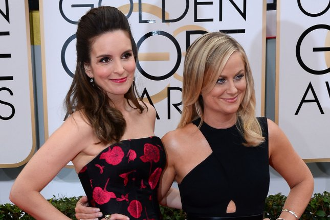 Tina Fey (L) and Amy Poehler will co-host the 2015 Golden Globe Awards. UPI/Jim Ruymen