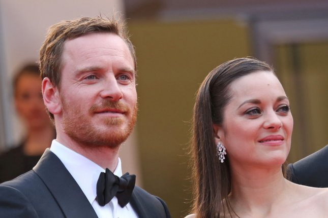 Michael Fassbender (L) with 'Macbeth' co-star Marion Cotillard. File photo by David Silpa/UPI