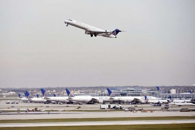 A United Airlines plane takes off as others wait at gates Nov. 5 at O'Hare International Airport. The Justice Department is investigating several major airlines for alleged price fixing. File photo by Brian Kersey/UPI