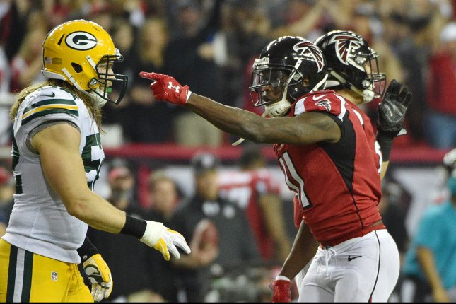 Atlanta Falcons wide receiver Julio Jones (11) reacts in front of Green Bay Packers outside linebacker Clay Matthews (52) after his first down during the first half of the NFC Championship game at the Georgia Dome on January 22, 2017 in Atlanta. Photo by David Tulis/UPI