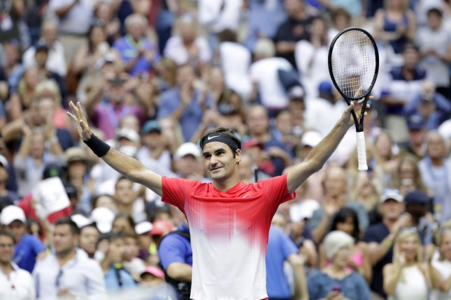 Roger Federer raises his hands after defeating Mikhail Youzhn at the 2017 US Open Tennis Championships Thursday in New York. Photo by John Angelillo/UPI